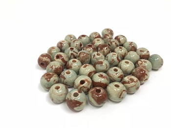 Claycult 8mm Round Ceramic Bead - Celadon on two tone clay
